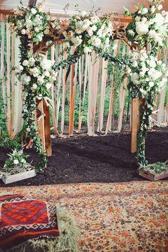 floral altar // photo by The Nichols // View more: http://ruffledblog.com/surprise-texas-wedding/