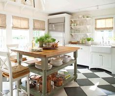 Great open kitchen island (less visual bulk than a closed island!). And, I love the black and white checkered floor!