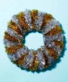 Wrap ropes of tinsel around a wreath frame for easy & sparkly decor.