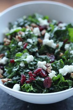 Holiday Kale Salad  - it has dried cranberries, walnuts, and goat cheese (sub blue cheese or feta)  via Channeling Contessa