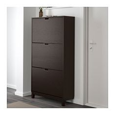 IKEA - STÄLL, Shoe cabinet with 3 compartments, black-brown, , Helps you organize your shoes and saves floor space at the same time.You will have room for plenty of shoes as each compartment has double rows.In the shoe cabinet your shoes get the ventilation and the space they need to keep them like new longer.The cabinet only has legs at the front so it can stand close up to the wall above the baseboard.