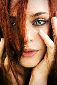 He's got a thing for redheaded women with green eyes and freckles.  (I've got green eyes, but I'm a blonde.)