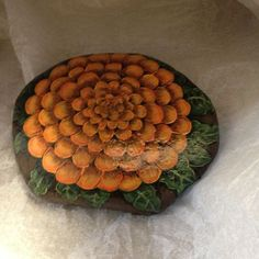 Hand+Painted+rock+of+orange+Mum+or+Marigold+bloom+by+gusismom,+$24.00