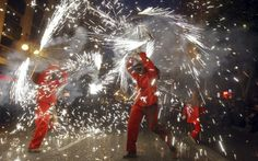 People enjoy a street fireworks display, or 'Correfoc' (Running Fire), in downtown Valencia, eastern Spain, on March Kai Foersterling / EPA Paper Mache Sculpture, Sculptures, Spring Vacation, Travel News, Travel Stuff, Valencia Spain, Fireworks, The Good Place, Christmas Bulbs