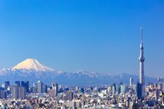The view of Mt. Fuji from Tokyo with Tokyo Skytree in the foreground.