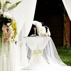 """This cocktail highboy makes a statement on its own! Create this alluring look by using our scuba 132"""" round linen with a floral wrap and some voile material to drape on top! VOILA!"""