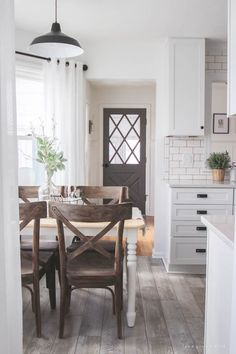I'm picturing the living room closed off to the right. I'm picturing this being taken while standing in the mud room/backyard. Small, homey and complete!  Clicking on the picture shows all! It is a closed off kitchen and dining but a big wall window to see the kids in the living room. The bathroom at the end of the hall? Perfection.