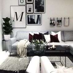 Gorgeous living room and photo wall with framed poster from Printler, the marketplace for photo art. Decorated by @verothesan at instagram. Contrasting interior design with black and white, plus some added colors to soften it up. Find your dream poster at https://printler.com/sv/