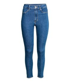Dark denim blue. Pants in washed superstretch twill with a high waist and slim legs. Mock pockets at front and regular pockets at back.