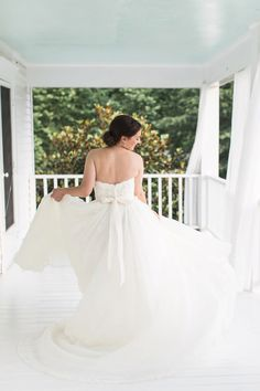 Love this shot of the bride twirling in her dress!
