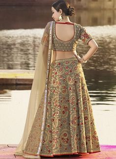 Light Grey and Beige Embroidered Silk Lehenga features a beautiful silk lehenga alongside a net dupatta. Embroidery work is completed with zari, thread, and stone.