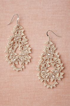 "Curvature Earrings $80.00 STYLE: 26451211  Lacy loops made of beads and pearls are a fresh twist on antique styling. From L'Orina. 2.25""L, 1.5""W. Freshwater pearls, glass beads, cotton thread, polyester, sterling silver. Handmade in France."
