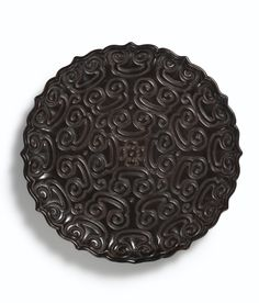 A black lacquer twelve-lobed tixi dish, Ming dynasty, 15th century