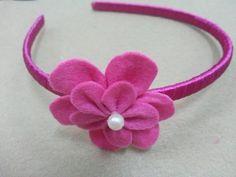 Easy felt flower headband tutorial. It's a cute accessory and perfect for all ages.    Materials    Headband  Felt fabric  Bead  Scissors  Needle and thread  Glue