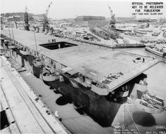 Carrier Independence under construction at Mare Island Naval Shipyard, California, United States, 11 Jul 1943; note hulls of submarines Spadefish and Trepang nearby