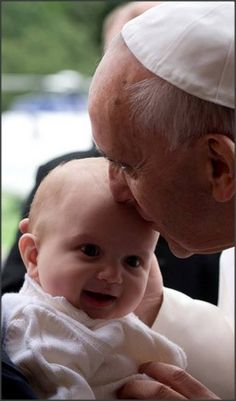 Pope Francis and baby.