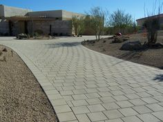 Simple yet elegant driveway with our 12 x 12 pavers.  #ackerstone #pavers…