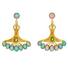 Art Nouveau Opal Tourmaline Gold Earrings. Circa 1905, 14k, American. These wonderful dangle earrings are lovely examples of the American interest in Victorian aesthetic movements. They artfully combine Art Nouveau with the Egyptian taste. The Papyrus flower-form decorated with shimmering opals has a mythic visual quality.
