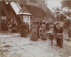 1903: Ladies on a freezing day, surrounding the 23rd Street entrance to the Sixth Avenue Elevated Railroad, placing them just a few blocks from the biggest department stores in the world. (Courtesy Museum of the City of New York) NYC: 6th Ave & 23rd St. historical photograph.