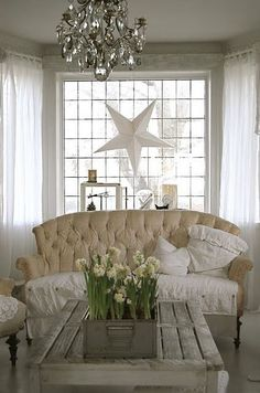 Shabby chic living room with paperwhites I am diggin the star hanging in the window