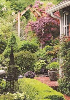 Cottage garden = very structured architectural shapes + various plant textures, heights, etc. and intermingled plantings