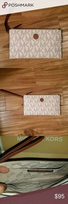 Michael Kors Vanilla Large Zip Clutch Brand new with tags. Vanilla with brown leather. Very pretty. Has inside credit card slots Michael Kors Bags Clutches & Wristlets