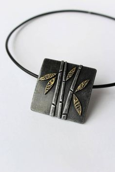 Polymer clay pendant Bamboo. Pendant height 4,5 cm (1.77) Pendant width 4,5 cm (1.77) Necklace length 45 cm (17.71) Inspired by nature and the beauty of plants and animals, my collection of polymer clay jewelry is stylish and wearable. The modern, original designs are meant to