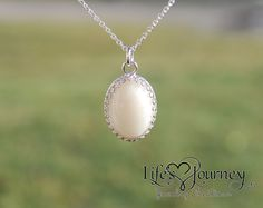 This vintage style oval pendant is 100% sterling silver, measures 18x13mm and is a gorgeous way to display your precious materials. Here the pendant is shown with breast milk and wedding sand combines