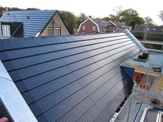 Solar panel roof tiles. (almost) free energy