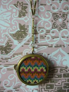 Cross Stitch Necklace  http://www.etsy.com/listing/84384009/double-sided-cross-stitch-necklace-the