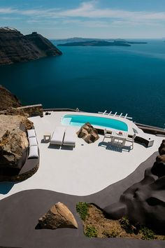 Aenaon Villas is a luxurious hotel perched atop the rocky hills of Santorini, Greece.