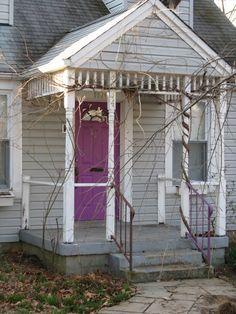 Purple door on a winter porch.