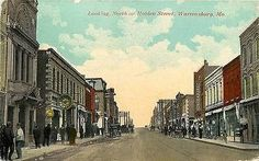Warrensburg Missouri MO 1913 Downtown North on Holden Street Vintage Postcard Warrensburg Missouri MO 1913 Downtown on Holden Street North. Used antique vintage postcard in very good condition with av