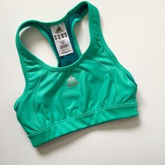 "Adidas Techfit Sports Bra Adidas sports bra with Techfit and ClimaCool technology. Aqua and Teal colors! The teal mesh is slightly sheer when stretched. Elastic band under the bust. This is a compression bra with dual layers over the bust! Material is stretchy- 91% polyester 9% spandex. Measures: 10 1/4"" band laying flat, 12"" from pit to pit, 11"" tall from strap to band. Barely worn so in great condition- minor wear. NO TRADES. Adidas Intimates & Sleepwear Bras"