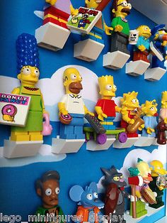 The final solution to your Lego Simpsons series 71009 minifigures collection. Show them in an organized way and keep them safe and dust Lego Display, Frame Display, Lego Simpsons, Lego Christmas Gifts, Lego Play Table, Lego Frame, Star Wars Figurines, Geek Room, Pallet Playhouse