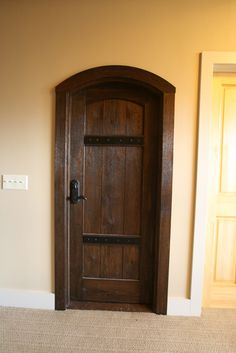 Custom stained oak with metal strapping makes a statment as the entry to the wine cellar in this upstate NY home. Doors, Arched Doors, Garage Makeover, Interior And Exterior, Custom Homes, Interior, Custom Interior Doors, Timber Frame, Doors Interior
