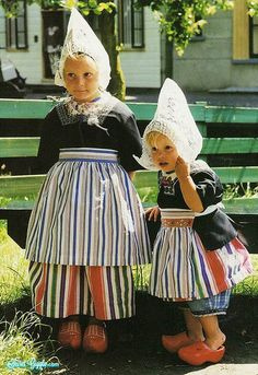 Little girls with wooden shoes -- must be Holland/The Netherlands. I have a pair of these in a child's size that my dad brought back after WWII.