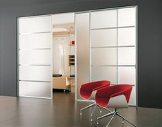 frosted glass sliding doors with aluminum trim and sections used as a partition in the living room for a walk-in closet or to separate a room into two living spaces | similar to ikea sekken sliding frosted glass doors for the pax wardrobe system