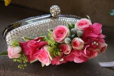 A lovely handbag corsage of Mimi Eden Rose Buds with Alfiflora Brunia and Hydrangea Florets