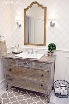 TIDBITS&TWINE Guest Bathroom Remodel - A mix of modern and vintage styles} love the antique dresser turned into bathroom vanity..the finish is perfect