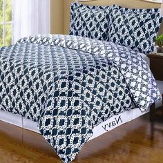 Moroccan Medallion Navy Blue White 100% Egyptian Duvet Comforter Cover and Shams Set.  The bedding set is reversible to the opposite print and color for two look in one.
