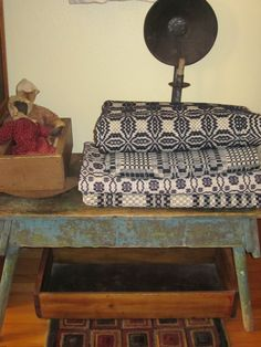 Antique blue benches, blue and white coverlets and goodies....