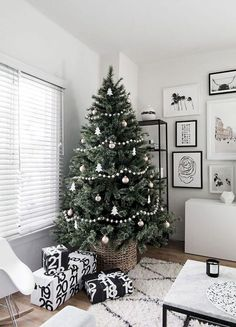 Simple Scandinavian Christmas Tree Decorating Inspiration — Mix & Match Design Company This modern, minimalist Christmas tree is beautiful in its simplicity. Love that it's in a basket Minimal Christmas, Elegant Christmas, Noel Christmas, Modern Christmas, Winter Christmas, Christmas Tree Simple, Minimalist Christmas Tree, Xmas Tree, Christmas Tree Basket