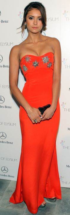 Nina Dobrev in beautiful, bold orange Pucci