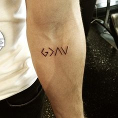 Small tattoos. 'God is greater than the highs and lows'.