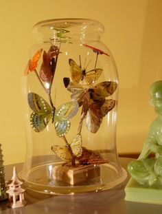 Learn how to make Bottled Butterflies as a great spring crafting idea.