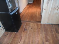 Custom Circle Sawn Hickory Floors with a custom made stain color.  Made by Superior Floors 518-623-2874