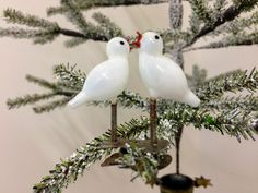 A pair of small free-blown milk glass chicks, attached to a clip with springs. Milk Glass, Glass Art, German, Bird, Ornaments, Free, Deutsch, German Language, Jar Art
