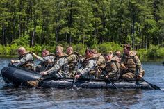 Soldiers, assigned to 82nd Combat Aviation Brigade, 82nd Airborne Division, row an inflatable boat across Mott Lake to recover and administer first aid to a simulated casualty on Fort Bragg, N.C., May 4, 2016. U.S. Army Photo by Staff Sgt. Christopher Freeman