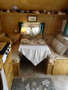 vintage camper ...I love the big pillows! Not so sure I want to keep a dining area in my camper tho, rather eat outside and have the space.
